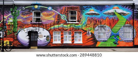 LONDON - JUNE 6, 2015. Temporary mural, spray painted with appied printed graphics, by artist Morganico on the facade of The Chelsea Arts Club in the Royal Borough of Kensington and Chelsea, London.