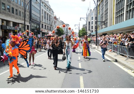 LONDON - JUNE 29: The annual Pride march goes through Londons Oxford Street the march celebrates Gay, Lesbian and Bi Sexual people , London June 29th, 2013 in London England. - stock photo