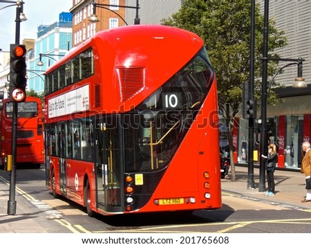 LONDON - JUNE 26. The hybrid 'New Bus For London' is now in service on several London bus routes. It is 50% more fuel efficient than existing diesel buses. June 26 2014 in London. - stock photo
