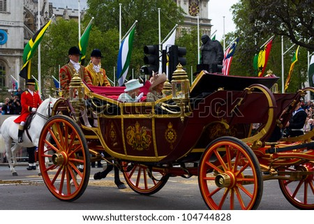 LONDON - JUNE 5: The Queen's carriage procession  makes its way to Buckingham Palace during the Jubilee on June 5, 2012 in London, England, UK. The diamond Jubilee marks 60 years of the Queen's reign - stock photo