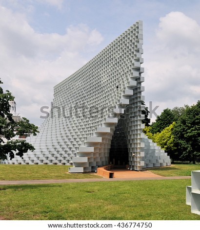 LONDON - JUNE 8, 2016. The Serpentine Gallery summer pavilion is designed by Danish architects BIG (Bjarke Ingels Group) with a structure of hollow fibreglass blocks in Kensington Gardens, London, UK. - stock photo