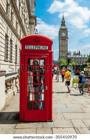 London - June 21, 2006., Traditional Red Phone box with Big Ben in background - stock photo