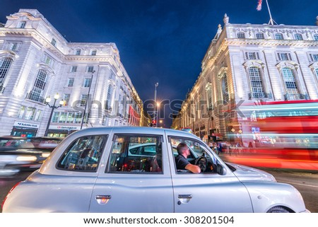LONDON - JUNE 11, 2015: Traffic and tourists at night in Regent Street near Piccadilly Circus. London attracts 50 million tourists annually.