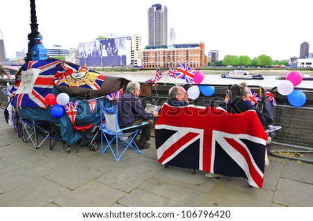 LONDON - JUNE 01: Unidentified people sleep in a tent alongside the River Thames to witness Thames Diamond Jubilee boats parade on June 1, 2012 in London. - stock photo