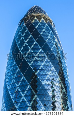 LONDON - JUNE 3, 2013: View of Gherkin building (30 St Mary Axe) at sunset in London. Gherkin - iconic symbol of London, one of city's most widely recognized examples of modern architecture. - stock photo