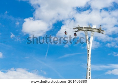 LONDON - JUNE 25 : View of the London cable car over the River Thames in London on June 25, 2014