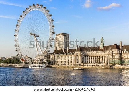 LONDON - JUNE 2, 2013: View of the London Eye at sunset. London Eye (135 m tall, diameter of 120 m) - a famous tourist attraction over river Thames in the capital city London. - stock photo