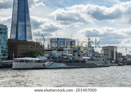 LONDON - JUNE 25 : View of the Shard and HMS Belfast in London on June 25, 2014. Unidentified people.