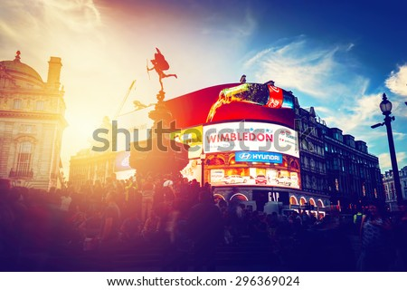 LONDON - JUNE 25: Vintage style artistic photograph of Piccadilly Circus neons at sunset, young night. This place is of the major tourist attractions on June 25, 2015 in London, UK. - stock photo