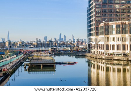 London low docks train Thames view with downtown, cucumber and city center buildings  - stock photo