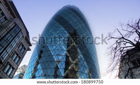 LONDON - March 9, 2014:A  HDR view of the Gherkin building ( 30 St Marys Axe)a 180 meter tall tower in London's financial district - stock photo