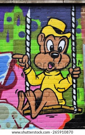 LONDON - MARCH 22, 2015. A painting on brickwork at Pedley Street in Shoreditch in the Borough of Tower Hamlets, an area renown for its street art in east London, UK.