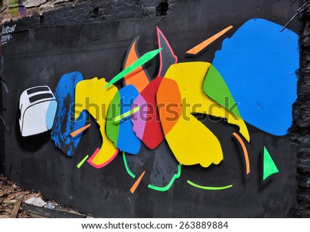 LONDON - MARCH 22, 2015. A wall painting on an old wall in a parking yard off Brick Lane, Shoreditch in the Borough of Tower Hamlets, an area renown for its street art in east London, UK. - stock photo