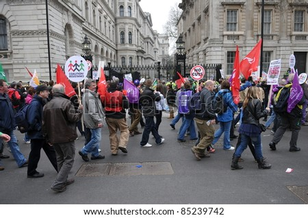 LONDON - MARCH 26: Anti-cuts protesters march past Whitehall on March 26, 2011 in London, UK. The TUC organized event rally drew an estimated 250,000 people to the streets of the British capital.