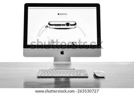 LONDON - MARCH 25: Apple iMac with the new iWatch displayed on the screen, image processed in black and white. March 25, 2015 in London, UK.