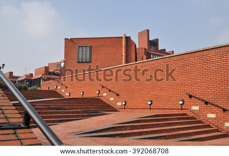 LONDON - MARCH 12, 2016. Brick entrance ramp and steps to the Hammersmith campus of the Ealing, Hammersmith and West London College, located in west London, UK. - stock photo