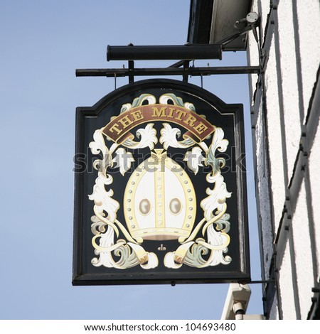 LONDON - MARCH 29: English pub sign, Public house, known as pub, is focal point of community, on March 29, 2012, London, UK. Pub business, now about 53,500 pubs in UK, has been declining every year - stock photo