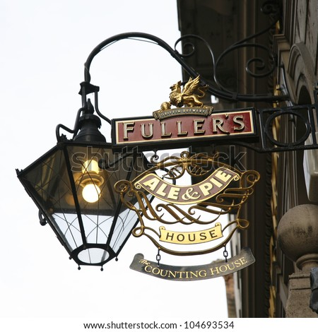 LONDON - MARCH 25: English pub sign, Public house, known as pub, is focal point of community, on March 25, 2012, London, UK. Pub business, now about 53,500 pubs in UK, has been declining every year - stock photo