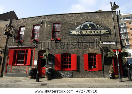 LONDON - MARCH 11: Exterior of pub; for drinking and socializing; focal point of community; on March 11; 2016; London; UK. Pub business; now about 53; 500 pubs in UK; has been declining every year
