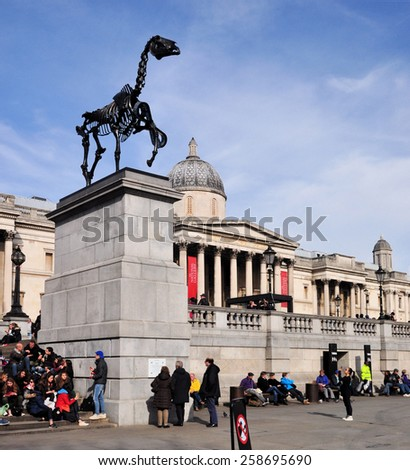 LONDON - MARCH 6, 2015. Hans Haacke's Gift Horse statue has an electronic ribbon displaying the Stock Exchange live ticker on temporary display on the fourth plinth in Trafalgar Square, London. - stock photo