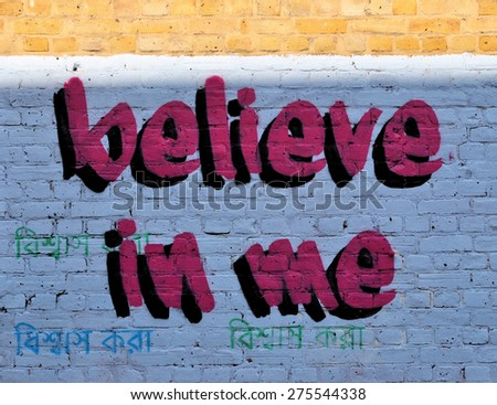 LONDON - MARCH 22, 2015. Message painted on a brick wall at Hanbury Street, Shoreditch, in the Borough of Tower Hamlets, an area renown for its street art in east London, UK. - stock photo