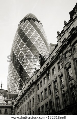 LONDON - MARCH 25: Outside view of 30 St Mary Axe, also called Gherkin, a skyscraper in the City of London, 180 metres height, 41 floors, completed in 2003, on March 25, 2012 in London, UK. - stock photo