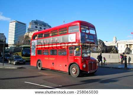 LONDON - MARCH 5: Routemaster Bus operating in London on March 5, 2015 in London, UK. The open platform facilitated speedy boarding under the supervision of a conductor.  - stock photo
