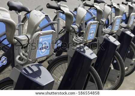 LONDON - MARCH 22: Row of hire bikes lined up in a docking station in London, on March 22, 2014. This bicycle sharing system was first introduced in London in July 2010.