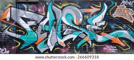 LONDON - MARCH 22, 2015. Street art on an on brickwork in Pedley Street at Shoreditch in the Borough of Tower Hamlets, an area renown for its public paintings in east London, UK. - stock photo