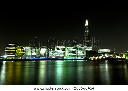 LONDON - MARCH 13th: London Cityscape at Night, showing The Shard, City Hall, More London and HMS Belfast with the River Thames - stock photo