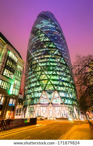LONDON - MARCH 16: The modern glass offices of the Swiss Re Gherkin on March 16, 2011 in London. the tower is 180 metres tall, and stands on the former site of the Baltic Exchange building. - stock photo