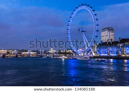LONDON - March 17: View of the London Eye on March 17, 2013 in London, England. London Eye - a famous tourist attraction over river Thames in the capital city London. - stock photo