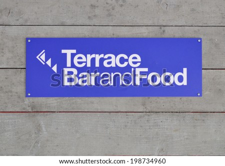 LONDON - MAY 3. A cafe sign at the Southbank Centre, on May 3, 2014, a complex of galleries, theatres and concert venues for music, dance, plays,  and exhibitions near the Thames in London. - stock photo