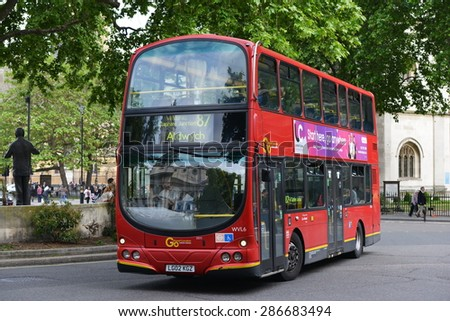 LONDON - MAY 30: A red Transport for London (TFL) bus carries passengers on a city centre street on May 30, 2015 in London, UK. TFL is responsible for mass transport systems in the British capital. - stock photo