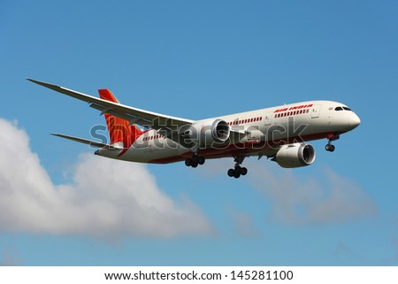 LONDON - MAY 25: An Air India Boeing 787 Dreamliner on approach on May 25, 2013 in London. The Boeing 787 is the world's first airliner to use composite materials in the construction of its airframe. - stock photo