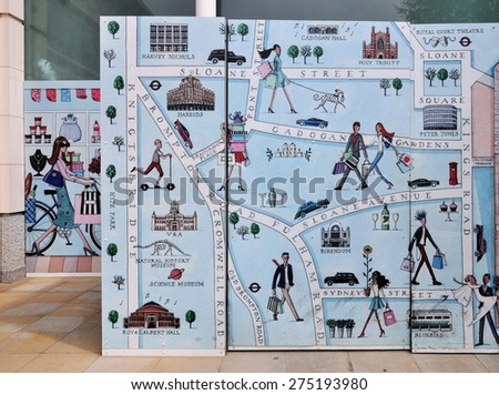 LONDON - MAY 2, 2015. An illustrative painted map decorates a temporary timber hoarding at a retail shopping precinct on the King's Road in the Royal Borough of Kensington & Chelsea, London, UK. - stock photo