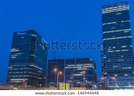LONDON - MAY 26: Barclays Head Quarter and HSBC UK Head Quarter at night on May 26, 2013, Canary Wharf, London. Canary Wharf is a major business district located in Borough of Tower Hamlets. - stock photo