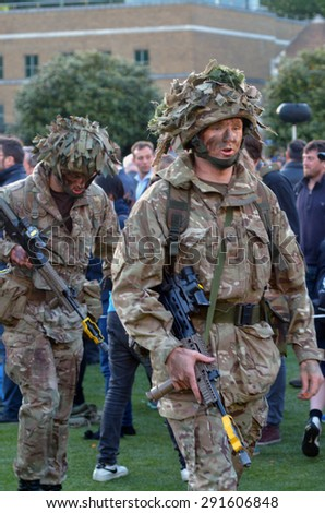 LONDON - MAY 14 2015:British Army soldiers.According to Ministry of Defence, it costs �£30,000 to train a soldier. Selection costs £7,000, while Basic Training and Combat Infantry Course cost £23,000. - stock photo