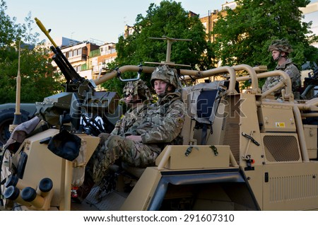 LONDON - MAY 14 2015:British Army soldiers.According to Ministry of Defence, it costs £30,000 to train a soldier.Selection costs £7,000, while Basic Training and Combat Infantry Course cost £23,000 - stock photo