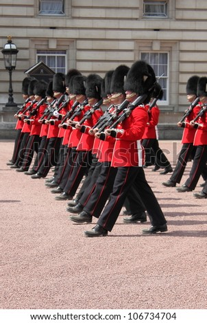 LONDON - MAY 21: British Royal guards performs the Changing of the Guard in Buckingham Palace on May 21, 2010 in London, UK - stock photo