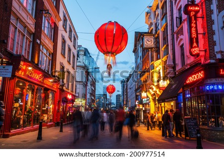 LONDON - MAY 23: Chinatown with unidentified people at night on May 23, 2014 in London. Chinatown is part of the Soho area with a range of Chinese restaurants and other Chinese run businesses. - stock photo