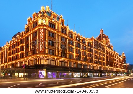 LONDON - MAY 27: Harrods department store in London, England on May 27, 2013. Harrods is the biggest department store in Europe and has over one million square feet of retail space. - stock photo