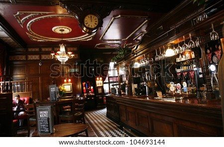 LONDON - MAY 5: Interior of pub, for drinking and socializing, focal point of community, on May 5, 2012, London, UK. Pub business, now about 53,500 pubs in the UK, has been declining every year - stock photo