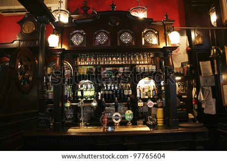 LONDON - MAY 7: Interior of pub, for drinking and socializing, focal point of the community, on May 7, 2006, London, UK. Pub business, now about 53,500 pubs in UK, has been declining every year - stock photo