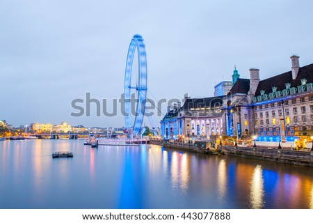LONDON - MAY 21: London Eye at night with river Thames on May 21, 2013 in London, UK. At a height of 135 meters, London Eye is the tallest Ferris wheel in Europe. - stock photo