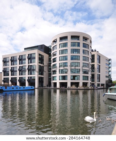 LONDON - MAY 25, 2015. New buildings along the Regent's Canal; an area undergoing major redevelopment at King's Cross in the Borough of Camden, London, UK.