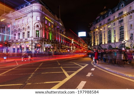 LONDON - MAY 23: night at the Piccadilly Circus on May 23, 2014 in London. Its the junction of some of the busiest streets in London. During British Empire he was referred as the center of the world - stock photo