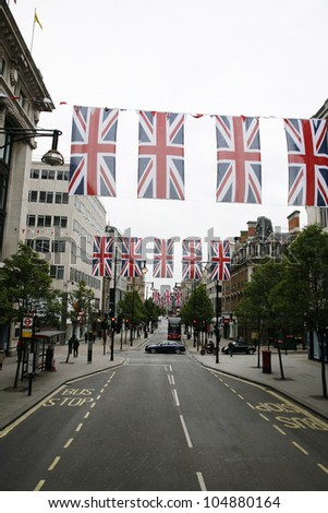 LONDON - MAY 5: Oxford Street in London, decorated with union jack flags to celebrate the Queen's diamond Jubilee on May 5, 2012 in London. The main celebrations held from June 2 to June 5 - stock photo