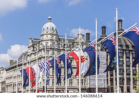 LONDON - MAY 31: Parliament Square is decorated with flags of the British Commonwealth to celebrate 60th Anniversary of Coronation of Britain's Queen Elizabeth II, on May 31, 2013 in London, England. - stock photo