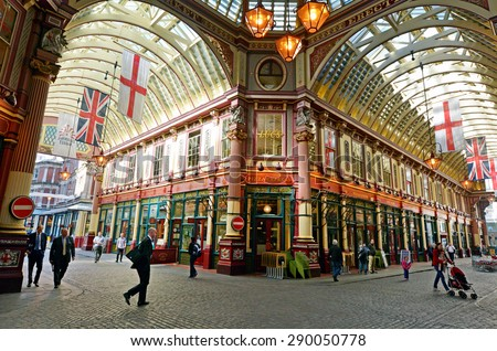 LONDON - MAY 13 2015:Pedestrians in Leadenhall Market in London, UK.It's one of the oldest markets in London, dating back to the 14th century, located in the historic centre of the City of London. - stock photo